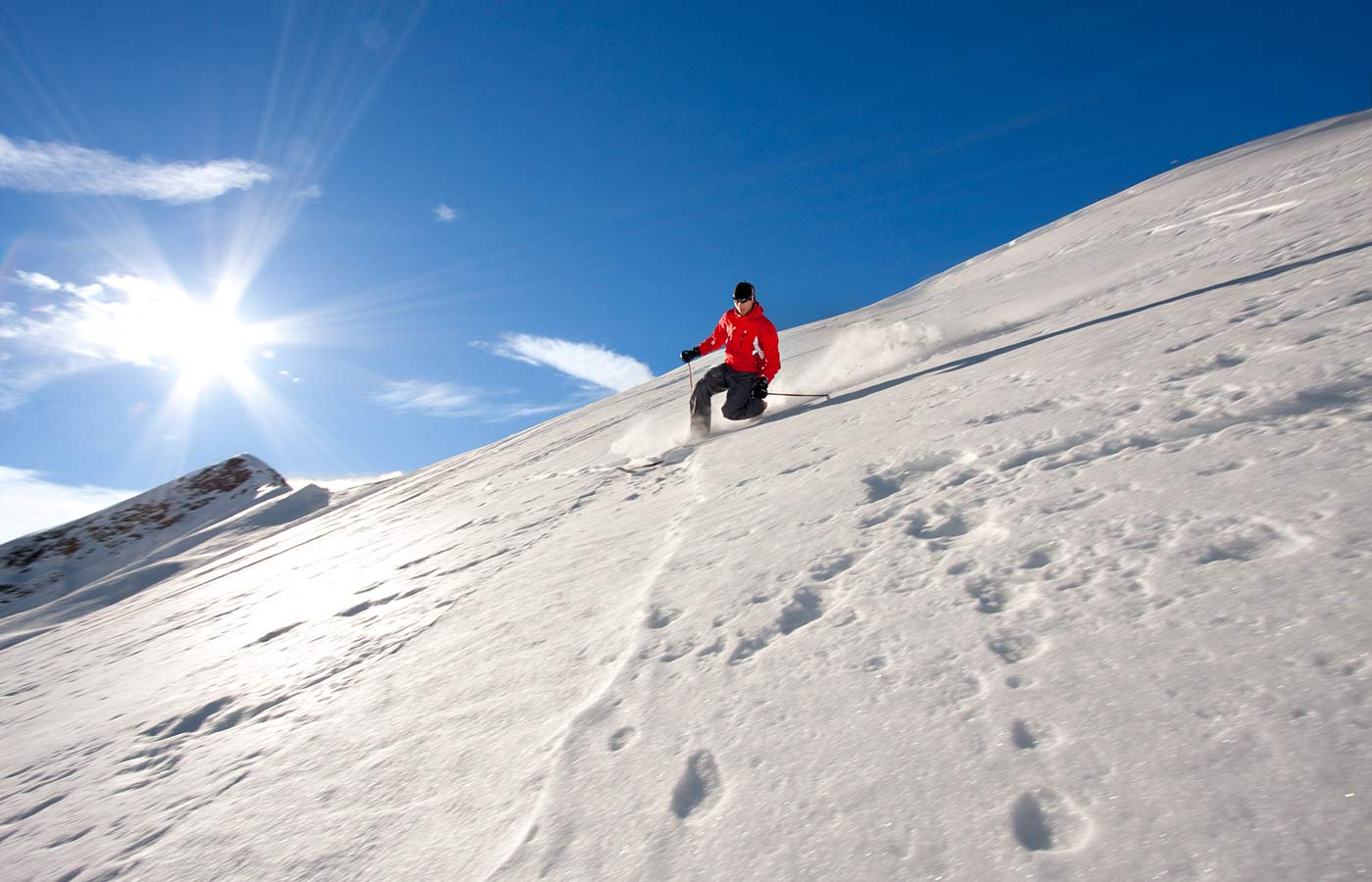 A skier practices telemark on a snow-covered slope on the mountain of South Tyrol in Italy