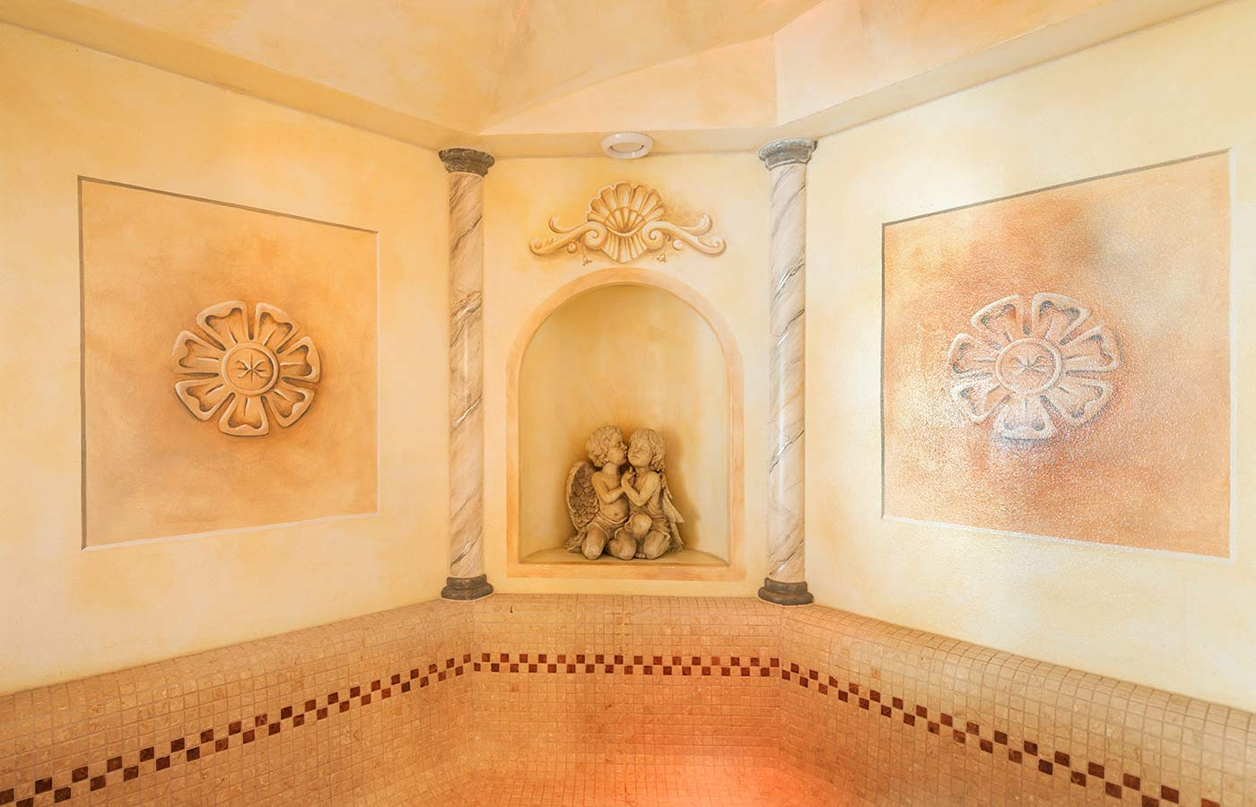 Mosaics and frescoes on the walls of the hammam in the spa at Hotel Waldheim