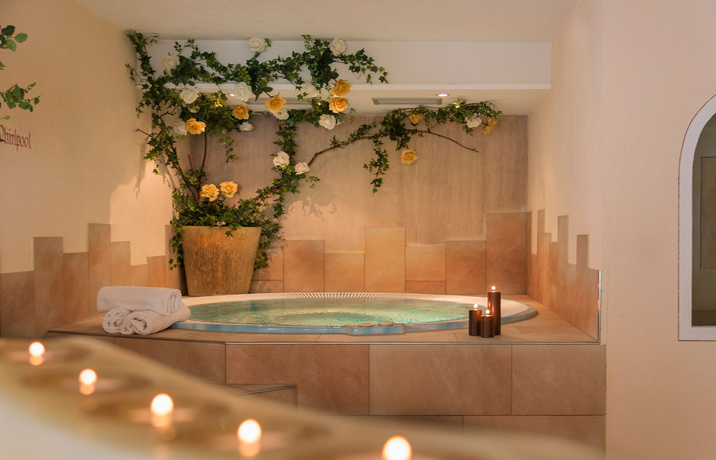Circular jacuzzi with candles and soft lighting atmosphere in the spa at Hotel Waldheim